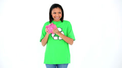 Gleeful cute environmental activist shaking happily a pink piggy bank Stock Footage