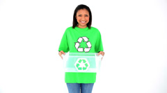 Friendly smiling environmental activist showing a basket with the recycling - stock footage