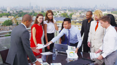 Attractive mixed ethnicity business team in open air meeting with city views Stock Footage