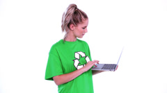 Young blonde environmental activist using her notebook - stock footage