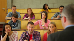 Student raising her hand to ask question in lecture Stock Footage
