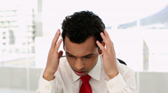 Frowning handsome businessman suffering a headache Stock Footage