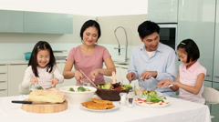 Happy family having dinner together - stock footage