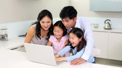 Happy family using laptop together - stock footage
