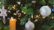 Stock Video Footage of Golden candle with holiday decorations in background
