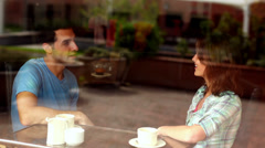 Couple chatting together in the canteen having coffee - stock footage