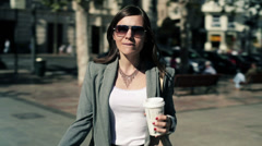 Confident businesswoman walking and drinking coffee in the city HD - stock footage