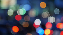 Stock Video Footage of Pan across city blur background. Moving bokeh circles of night traffic.