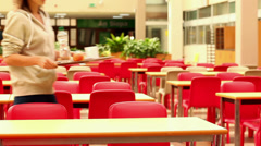 Upset student eating lunch alone Stock Footage