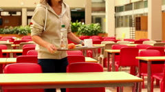 Unhappy student eating lunch alone Stock Footage