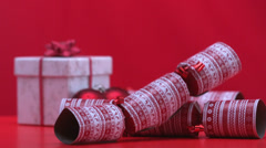 Stock Video Footage of Christmas crackers falling and bouncing beside present