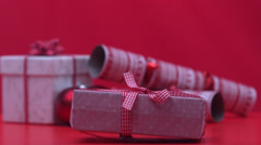 Stock Video Footage of Christmas present dropping and bouncing beside crackers