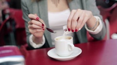 Businesswoman sweetening and drinking coffee in cafe HD Stock Footage