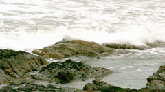 Waves rolling in over the rocks - stock footage