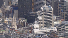 Aerial view above buildings in the city of London Stock Footage