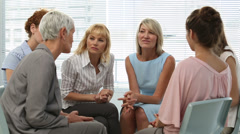Businesswomen sitting and chatting after a seminar Stock Footage