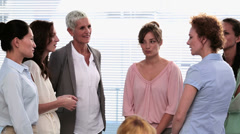 Businesswomen standing and talking after a seminar Stock Footage