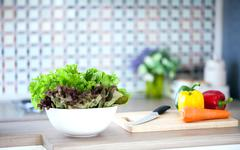 Stock Photo of green salad in domestic kitchen