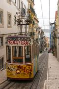 short and quick trams in lisbon, portugal. - stock photo