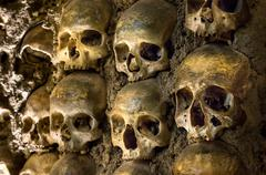 wall full of skulls and bones in the bone chapel in evora, portugal - stock photo