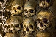 Stock Photo of wall full of skulls and bones in the bone chapel in evora, portugal