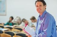 Stock Photo of Teacher with young college students in the classroom