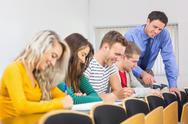 Stock Photo of Teacher with college students at the classroom