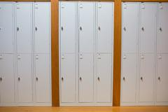 Closed lockers in a row at the college - stock photo