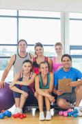 Portrait of an instructor with fitness class - stock photo