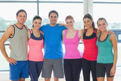 Portrait of a group of fitness class at exercise room Stock Photos