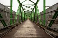 Stock Photo of Footbridge with symmetrical metal structure