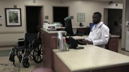 Stock Video Footage of doctor at desk