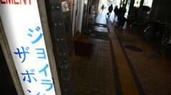 People walking near pachinko parlor near Yurakucho, Tokyo Stock Footage