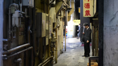 Japanese salary-man smoking in an alley near Yurakucho, Tokyo Stock Footage