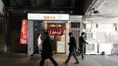 People walking in a passageway below Yurakucho Station, Tokyo Stock Footage