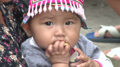 Lahu Hilltribe Baby Eating Snack In Rural Thailand Stock Footage