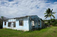 destroyed house from cyclone pat  in aitutaki lagoon cook islands - stock photo