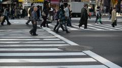 Pedestrians at crosswalk in Ginza, Tokyo Stock Footage