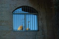 Crescent moon in window of jewish house in jerusalem Stock Photos