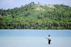 casting for bonefish in aitutaki lagoon cook islands - stock photo