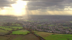 Panoramic aerial view over England where the city meets the countryside - stock footage