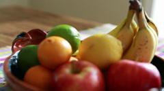 Beautiful fruit on a table rack focus Stock Footage