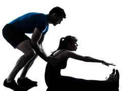 aerobics intstructor  with mature woman exercising silhouette - stock photo