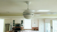 A ceiling fan turned on in a house Stock Footage