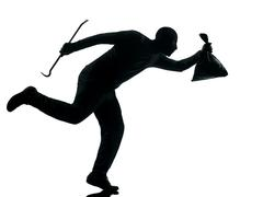 Man thief criminal running silhouette Stock Photos