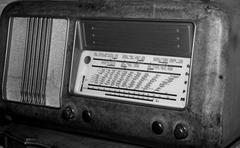vintage radio of the last century with the knobs to adjust the radio channels - stock photo