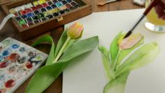 Painting with paintbrush orange tulip bud in watercolors. Time lapse Stock Footage