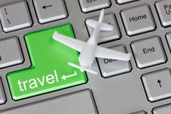 Plane  on keyboard with travel button Stock Photos