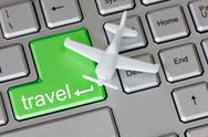 Stock Photo of plane  on keyboard with travel button