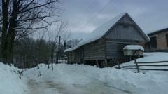 Old wooden house in snow. Carpathians, Ukraine. - stock footage